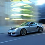 2011 Silver Porsche 911 GT2 RS wallpaper Side angle view