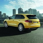 Yellow Porsche Cayenne 2011 1600x1200 wallpaper Rear angle view