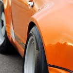 Singer Racing Orange Porsche 911 Angle side view