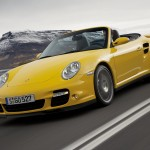 2008 Yellow Porsche 911 Turbo Cabriolet Wallpaper Fronta angle view In motion