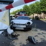 Girl crashes Porsche Cayman in Riga Latvia